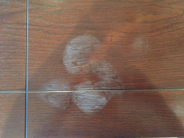 q how can i remove white heat water marks from my dining room table