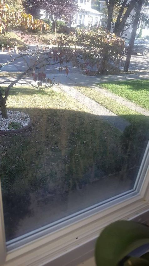 q how can i get rid of water marks on my glass window