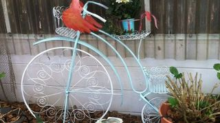 , I spray painted it aqua with white wheels and attached a metal Flamingo