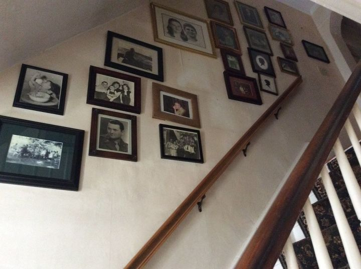q need to re hang pictures on a staircase wall nail holes enlarged