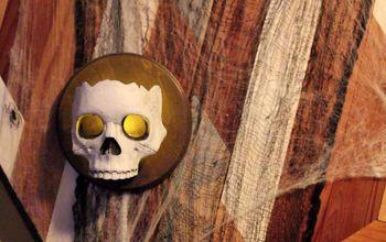 DIY Dollar Store Skull Sconces