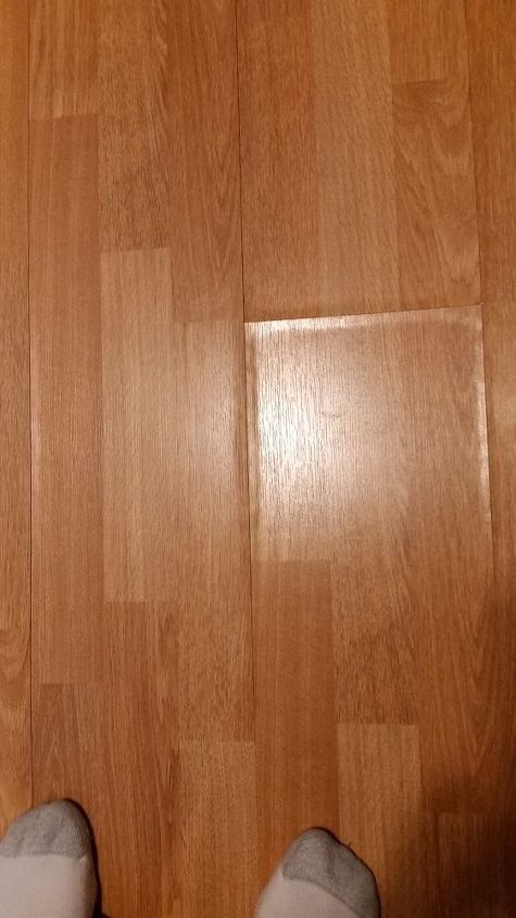 q how do you fix a laminate floor that has swelled after a fridge leak