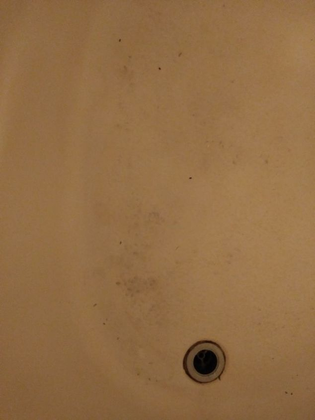 q dirty and discolored looking fiberglass tub