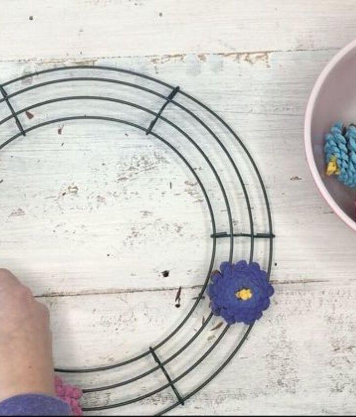 s 3 wreath ideas to brighten up your front door, Step 5 Grab wire wreath twist the pinecone