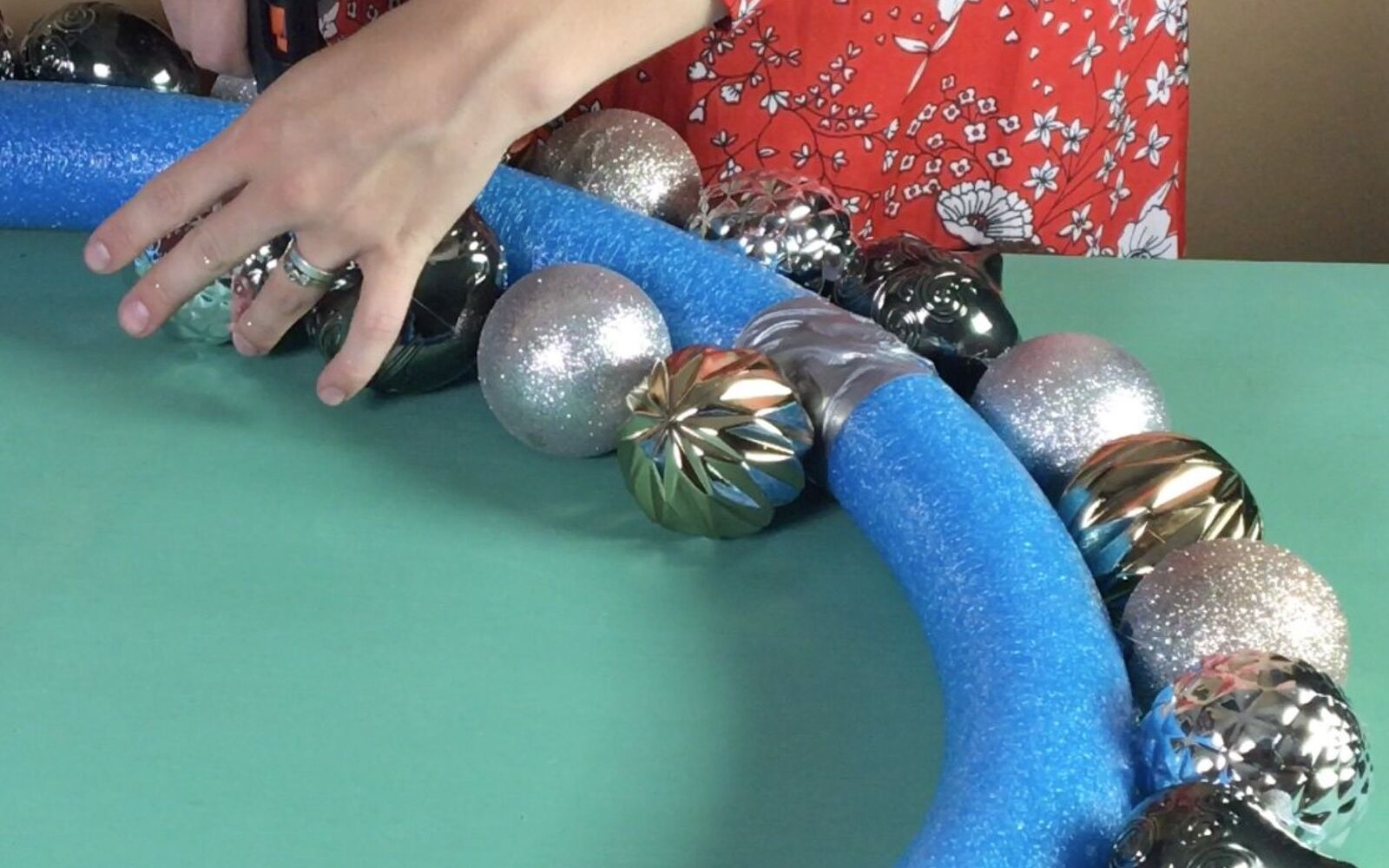 s 3 wreath ideas to brighten up your front door, Step 4 Hot glue ornaments to the inner edge