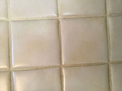 How to fix grout that was sealed when dirty looks awful hometalk and grout cleaners and scrub brushes nothing works any thoughts besides the obvious re tile the floor this is a very high traffic area thank you ppazfo