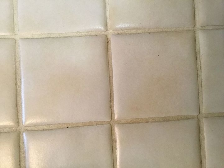 q how to fix grout that was sealed when dirty looks awful