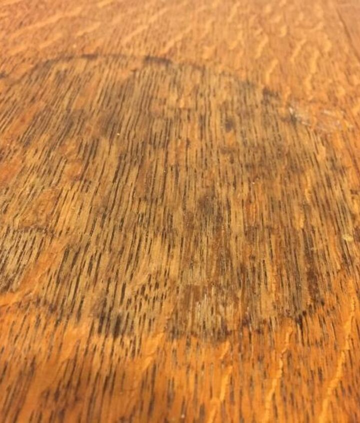 q does anyone know how to get a watermark off of an old wood table top