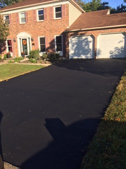 how to seal coat a driveway
