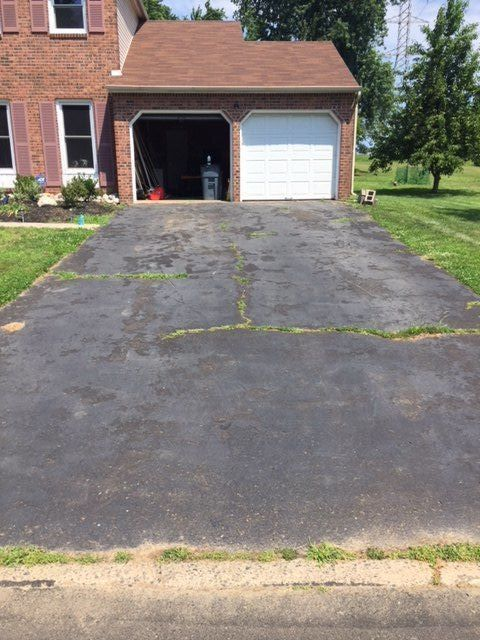 Do This To Make Your Cracked Driveway Look So Much Better