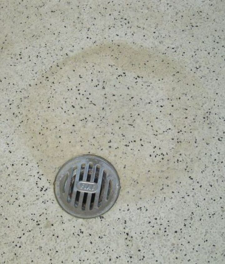 q how do i clean stains from a glazed concrete shower floor