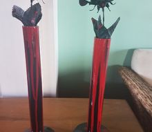 vase painted to look like a black candle dripping red wax