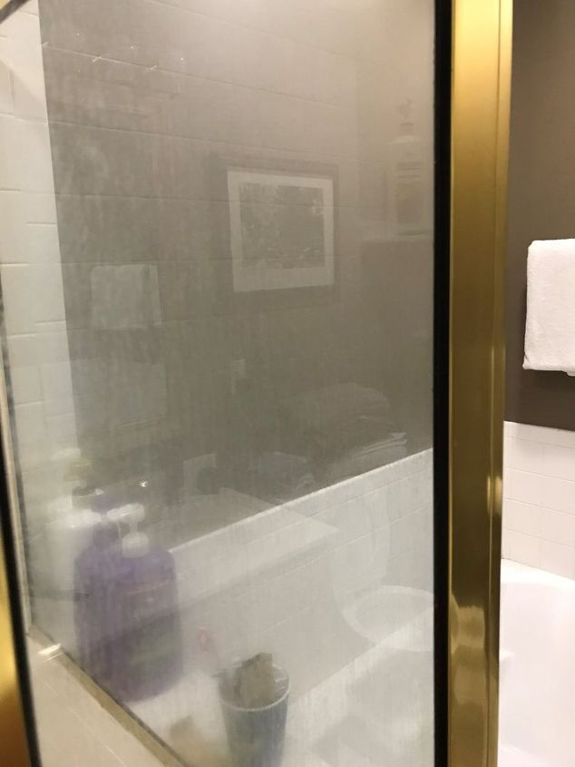 q how to clear shower glass from long standing hard water soap