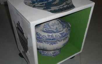 a small decoupaged wheeling box