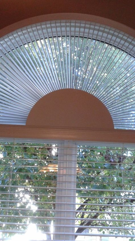 q how to wash a inside 72 inch arched window without removing the blinds