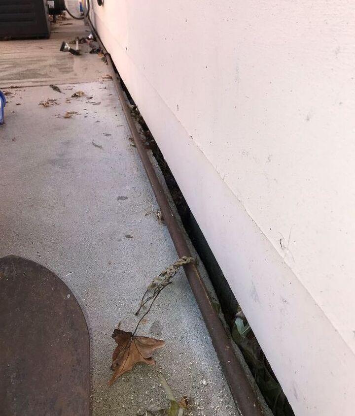 q how to fill gap between house slab and sidewalk yard