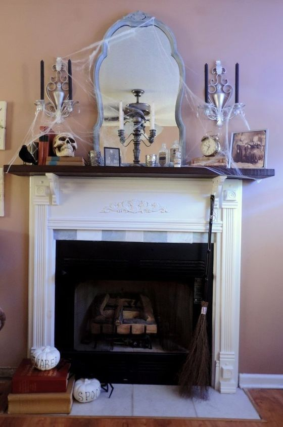 a spooky haunted library inspired halloween mantel