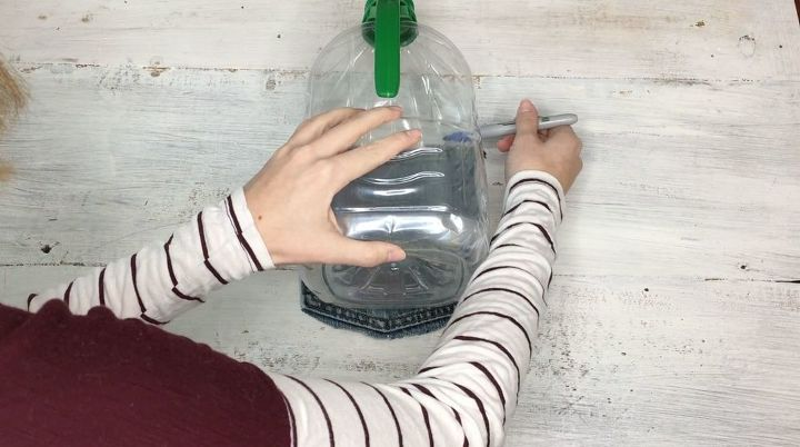 s step by step upcycle your old clothing items for these great ideas, Step 2 Mark size of pocket on empty bottle