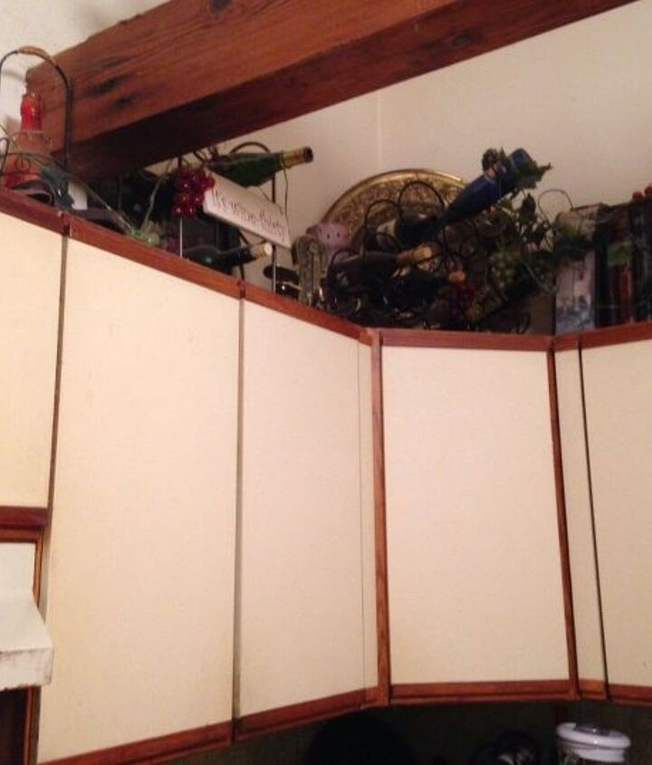 q what can i do to make my awful melamine cabinets look less awful