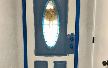 painting a paneled door with a window