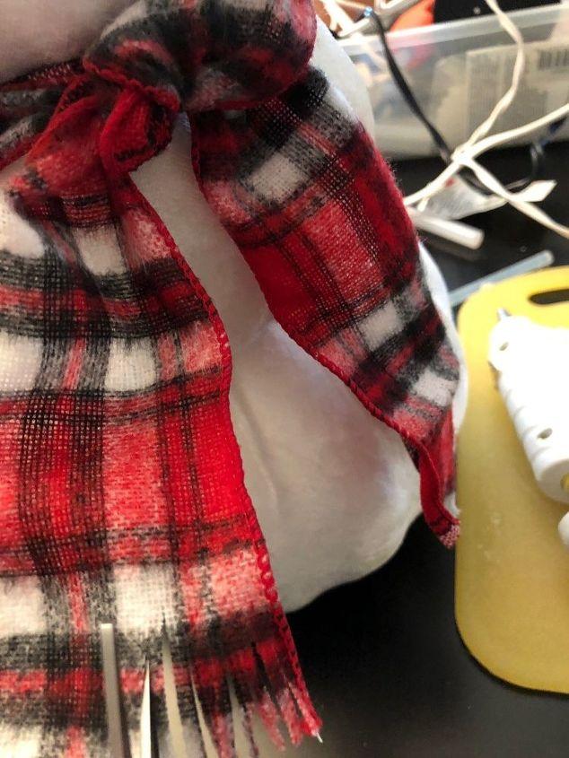 Cut fringe on scarf ends.