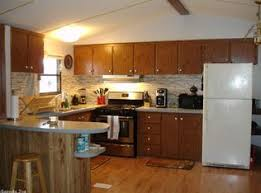 q need ideas to renovate particle board kitchen cabinets