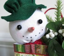 take a peek at this sock snowman peeking out of a holiday gift bag