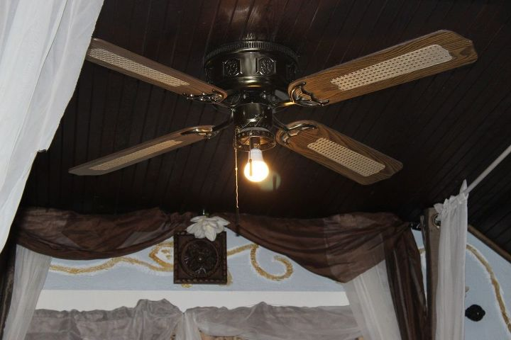 Ceiling fan with light in center of canopy.