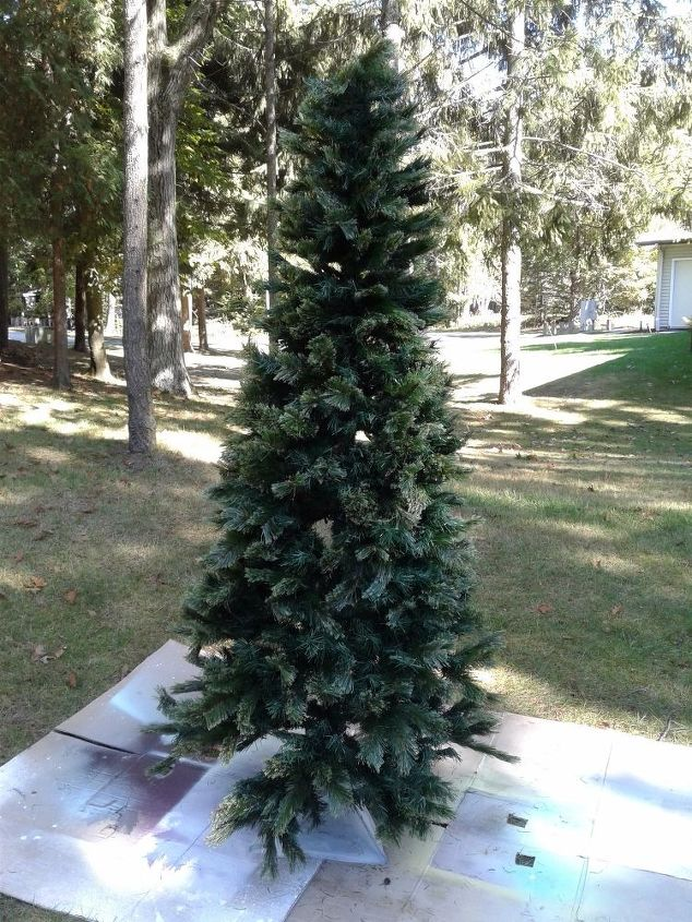 give an old worn out christmas tree new life with a little paint