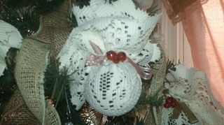 , Here is one example of my Victorian Glass balls for my tree covered in a lace doily I added holly berries bought springs at dollar store and used ribbon to tie with