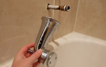 how to remove a stuck tub filler