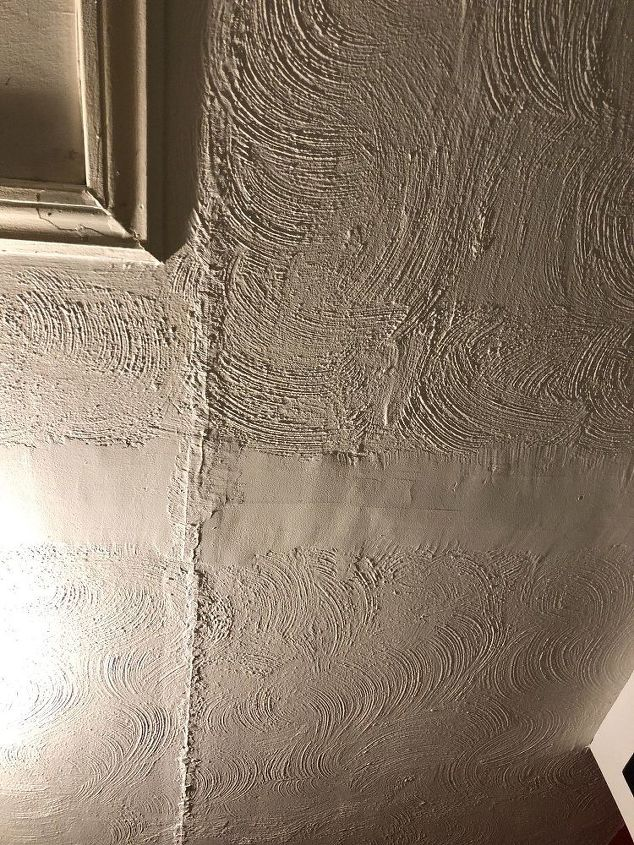 q we need suggestions on how to disguise an unevenly textured ceiling