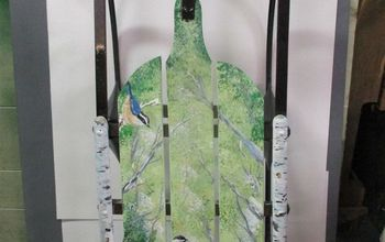 a painted sled for christmas with chickadees and nuthatch