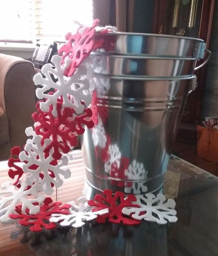 galvanized metal pails turned outdoor winter planters