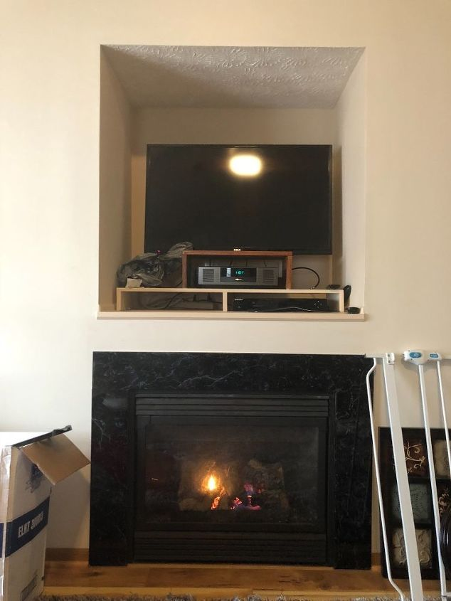 q tv cut out over fireplace