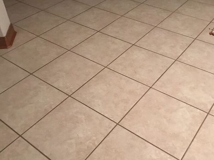 q how can i reduce the slipperiness of my tile floor