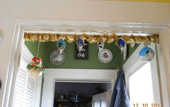 Hanging Ornaments With Cats In The House