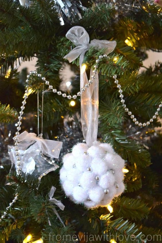 s 25 adorable ornament ideas to get you super excited for christmas, Create an Easy Pom Pom Ornament