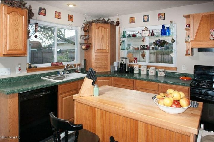 What to do with a kitchen with wood cabinets and green ...