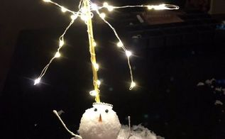 star of wonder snowman, Raise its stick arms