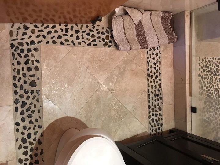 q how do you clean natural pebbles with grout and marble
