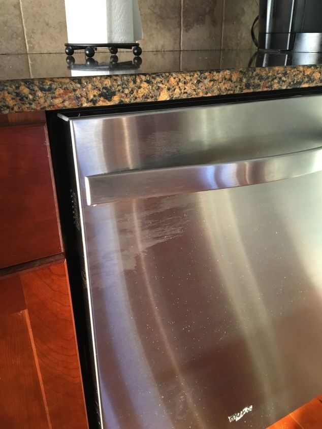 q how to remove residue on dishwasher