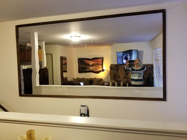 q i have a 4 x 8 mirror that was hung incorrectly over stairway