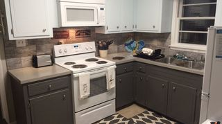 , After I also tiled the backsplash and used a countertop refinishing kit called Spreadstone by Daisch Coatings from Home Depot available online The countertops were the easiest DIY project
