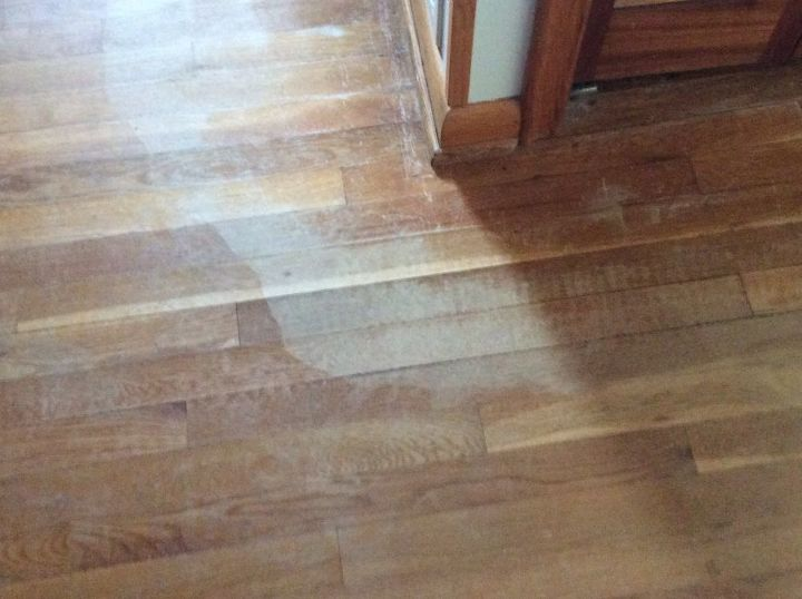 q what can i apply to water marked areas of my old hardwood floors