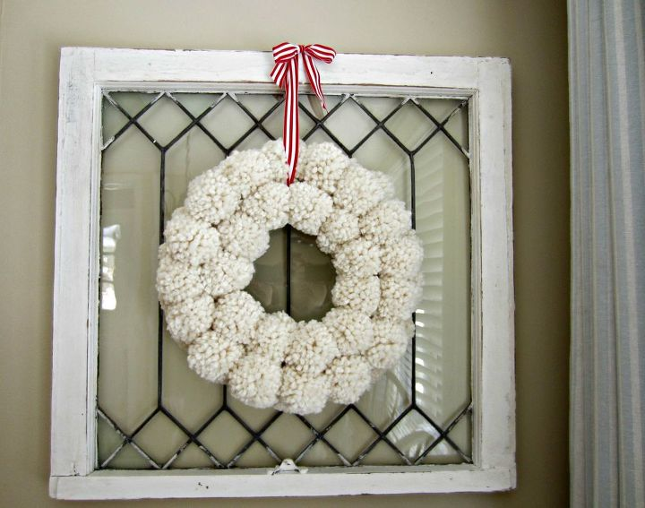 s 20 wintery wreath ideas that you ll want to make for your home, Fluffy Pom Pom Wreath