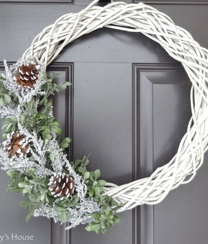 s 20 wintery wreath ideas that you ll want to make for your home, Farmhouse Pinecone Wreath