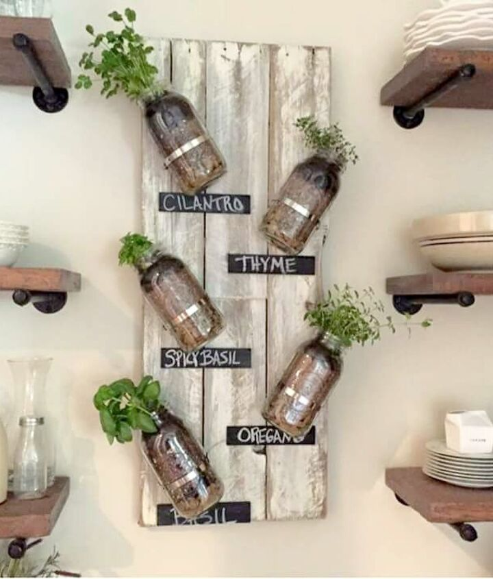 s these herb garden ideas will make you want to start one of your own, Mounted Mason Jar Herb Garden