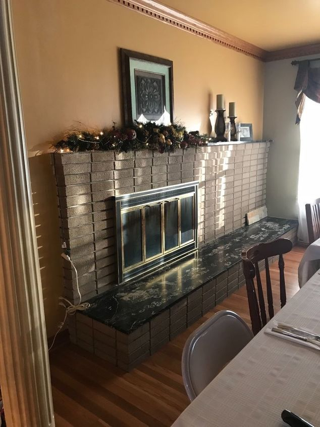 q what should i do to update an off centered and outdated fireplace