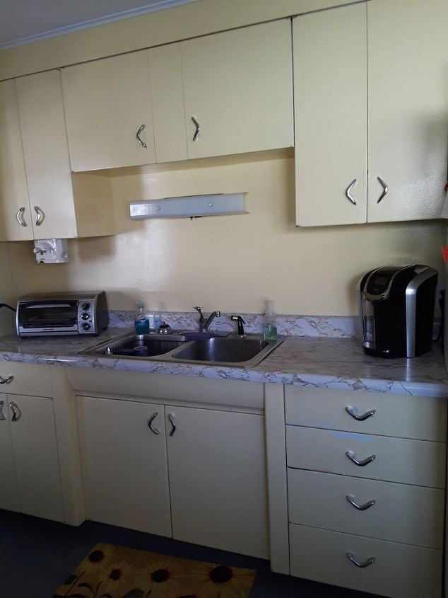 How can I change up old metal kitchen cabinets besides painting them ...